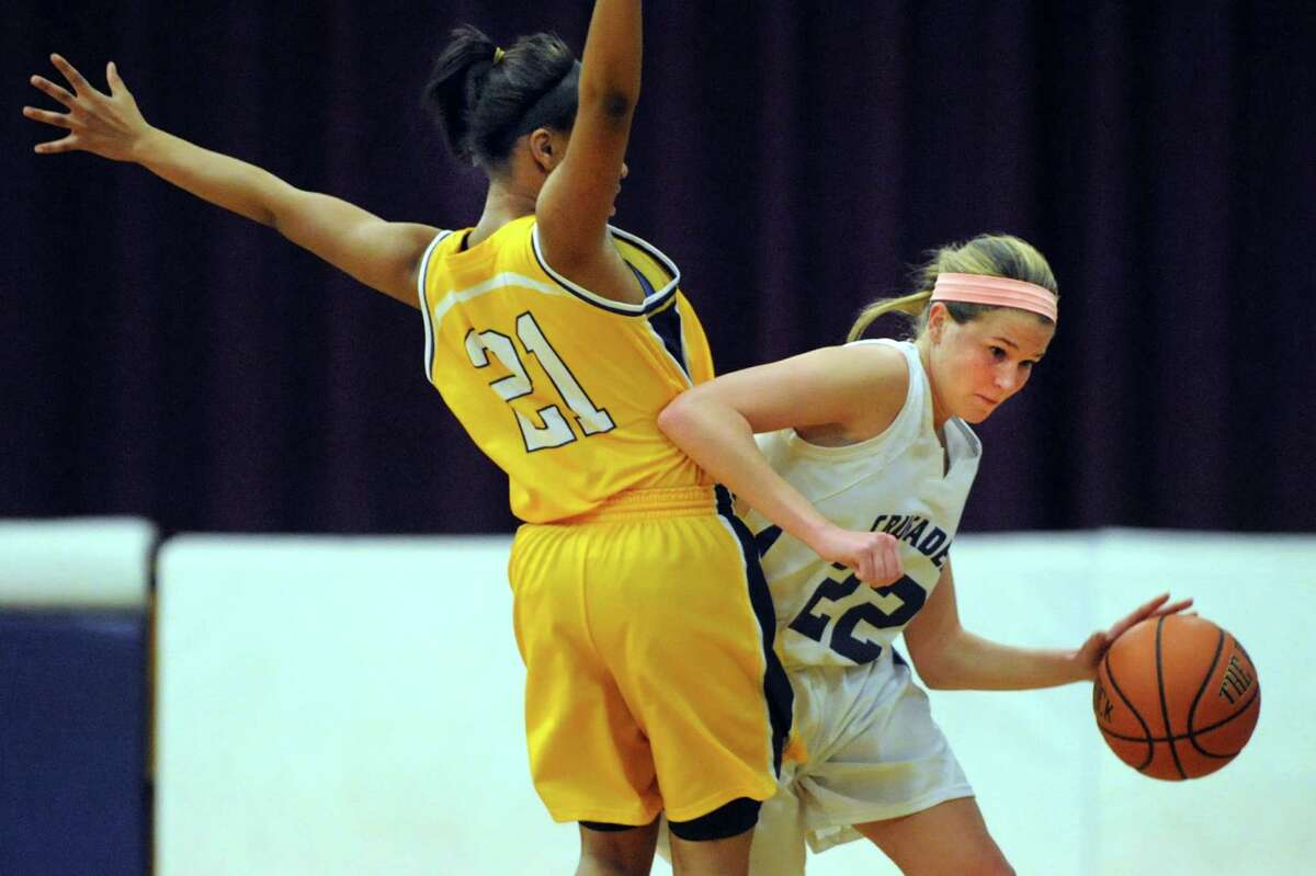 Catholic Central's Madison Purcell, right, drives the ball as Troy's Alliyah Gillespie defends during their basketball game on Friday, Dec. 20, 2013, at Catholic Central High in Troy, N.Y (Cindy Schultz / Times Union)
