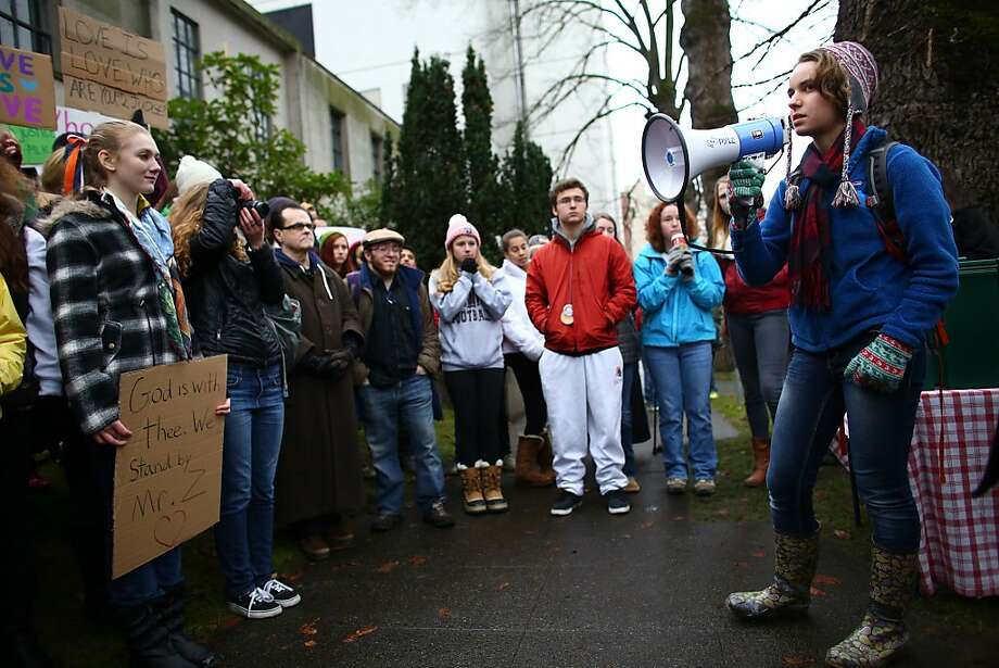 Holy Names Catholic High School senior Audrey Long talks about coming out as gay her freshman year wile gathered with other students outside of the Chancery building for the Archdiocese of Seattle, Friday, Dec. 20, 2013, in Seattle. The students were rallying for Eastside Catholic's Vice Principal Mike Zmuda, who resigned his position after officials with the archdiocese discovered that he was in a same-sex marriage. He was told the marriage violated his contract. (AP Photo/seattlepi.com, Joshua Trujillo) Photo: Joshua Trujillo, Associated Press