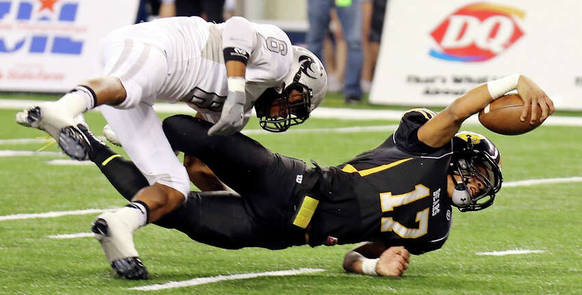Brennan's Da'Shawn Key stretches for the end zone as he is tackled by Denton Guyer's Demontrie Taylor during first half action of their Class 4A Division I state championship game Friday Dec. 20, 2013 at AT&T Stadium in Arlington, Tx.
