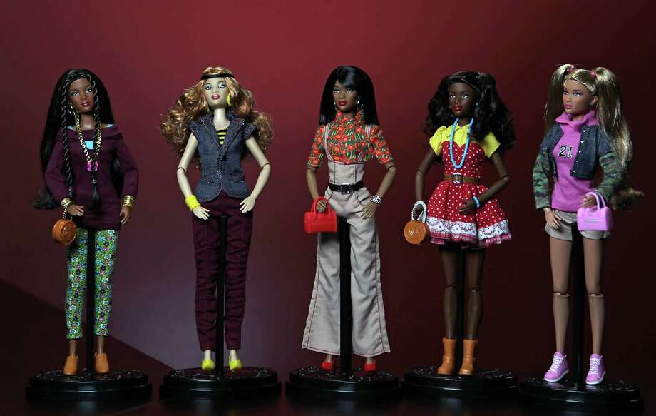 "The ""Prettie Girls"" dolls retail for $21. 95, and the Cynthia Bailey doll sells for $69.95. More information is available at www.oneworlddolls.com. Photo: James Nielsen, Staff / © 2013  Houston Chronicle"
