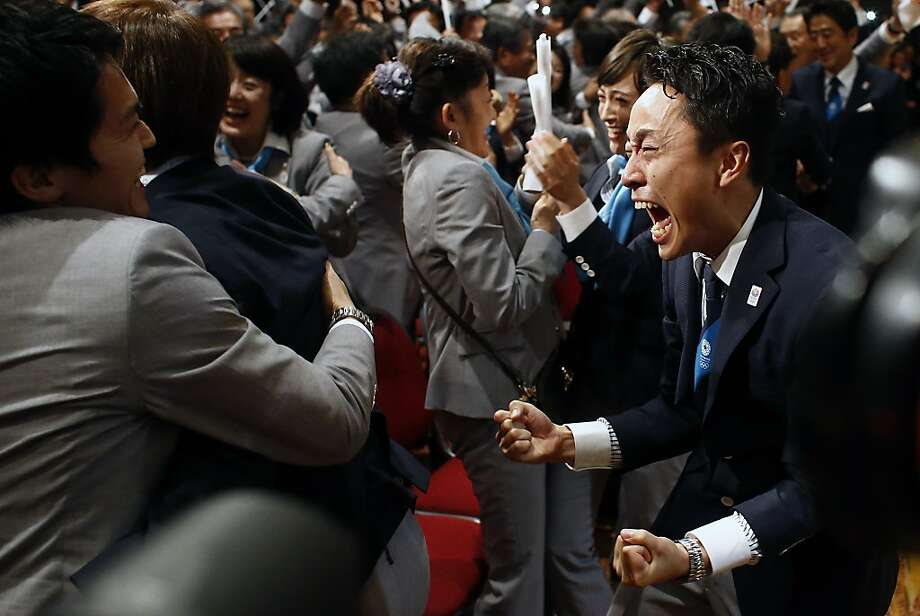 Members of the Tokyo 2020 delegation celebrate after Tokyo was awarded the 2020 Olympic Games during the 125th IOC session in Buenos Aires, Argentina,  Saturday, Sept. 7, 2013. Photo: Victor R. Caivano, Associated Press