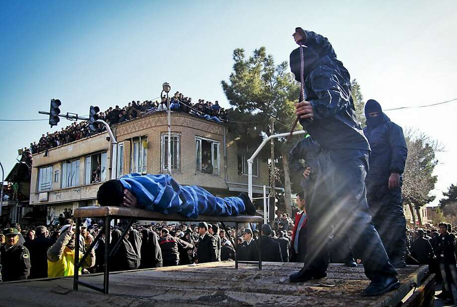 An Iranian officer lashes a man, convicted of rape, at the northeastern city of Sabzevar, Iran, Wednesday, Jan. 16, 2013. Rape, like murder and treason, can be punished by the death sentence in Iran, but sometimes judges imposed a sentence of lashes before execution or imprisonment. Photo: Hossein Esmaeli, Associated Press