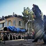 An Iranian officer lashes a man, convicted of rape, at the northeastern city of Sabzevar, Iran, Wednesday, Jan. 16, 2013. Rape, like murder and treason, can be punished by the death sentence in Iran, but sometimes judges imposed a sentence of lashes before execution or imprisonment.