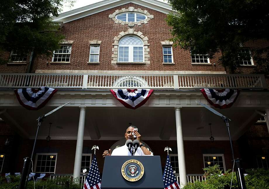President Barack Obama wipes away sweat as he speaks about climate change at Georgetown University in Washington, June 25, 2013. Obama proposed a sweeping plan to address climate change on Tuesday, setting ambitious goals and timetables for a series of executive actions to reduce greenhouse gas pollution and prepare the nation for the ravages of a warming planet.  Photo: Christopher Gregory, New York Times