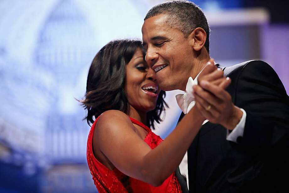 U.S. President Barack Obama and first lady Michelle Obama sing together as they dance during the Inaugural Ball at the Walter Washington Convention Center January 21, 2013 in Washington, DC. Obama was sworn-in for his second term of office earlier in the day. Photo: Chip Somodevilla, Getty Images