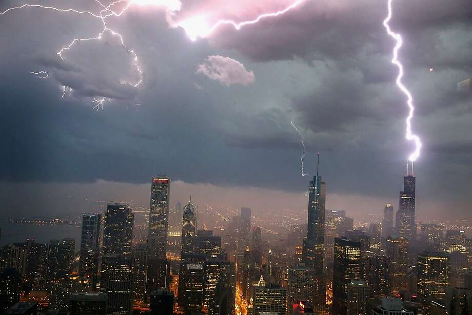 Lightning strikes the Willis Tower (formerly Sears Tower) in downtown on June 12, 2013 in Chicago, Illinois. A massive storm system with heavy rain, high winds, hail and possible tornadoes is expected to move into Illinois and much of the central part of the Midwest today. Photo: Scott Olson, Getty Images