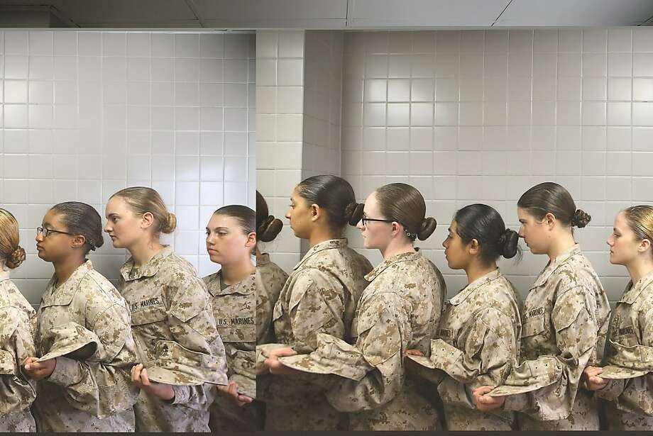 Female Marine recruits stand in line before getting lunch in the chow hall during boot camp on February 26, 2013 at MCRD Parris Island, South Carolina. Female enlisted Marines have gone through recruit training at the base since 1949. About 11 percent of female recruits who arrive at the boot camp fail to complete the training, which can be physically and mentally demanding. On January 24, 2013 Secretary of Defense Leon Panetta rescinded an order, which had been in place since 1994, that restricted women from being attached to ground combat units. Photo: Scott Olson, Getty Images