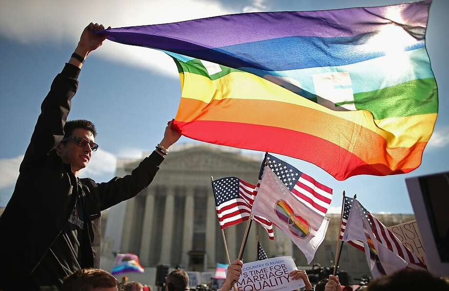 Eric Breese (L) of Rochester, New York, joins fellow George Washington University students and hundreds of others to rally outside the Supreme Court during oral arguments in a case challenging the Defense of Marriage Act (DOMA) March 27, 2013 in Washington, DC. The Supreme Court will hear arguments in the second case this week about same-sex marriage. Photo: Chip Somodevilla, Getty Images
