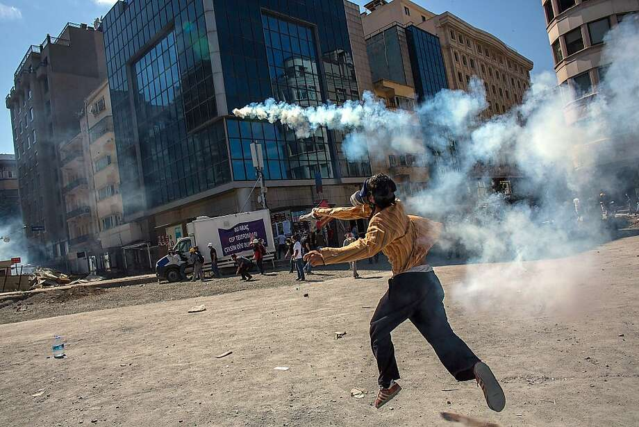 Protesters clash with riot police during a demonstration near Taksim Square on June 11, 2013 in Istanbul, Turkey. Istanbul has seen protests rage on for days, with two protesters and one police officer killed. What began as a protest over the fate of Taksim Gezi Park, has turned, with the heavy-handed response by police, into a protest over what is being seen as Prime Minister Recep Tayyip Erdogan's increasingly authoritarian agenda. Photo: Lam Yik Fei, Getty Images
