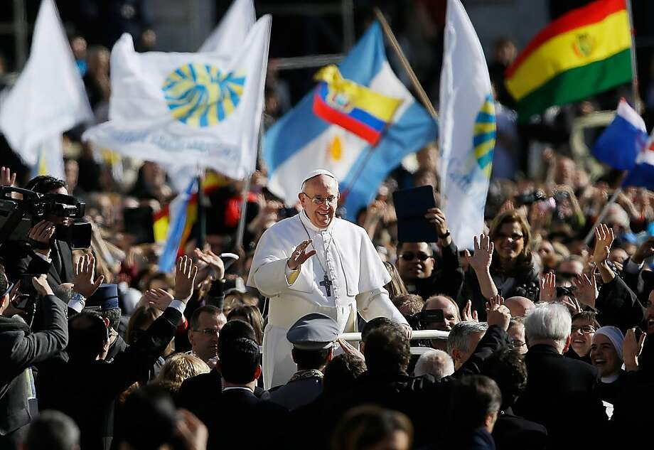 Pope Francis waves to crowds as he arrives to his inauguration Mass in St. Peter's Square at the Vatican, Tuesday, March 19, 2013. Photo: Gregorio Borgia, Associated Press