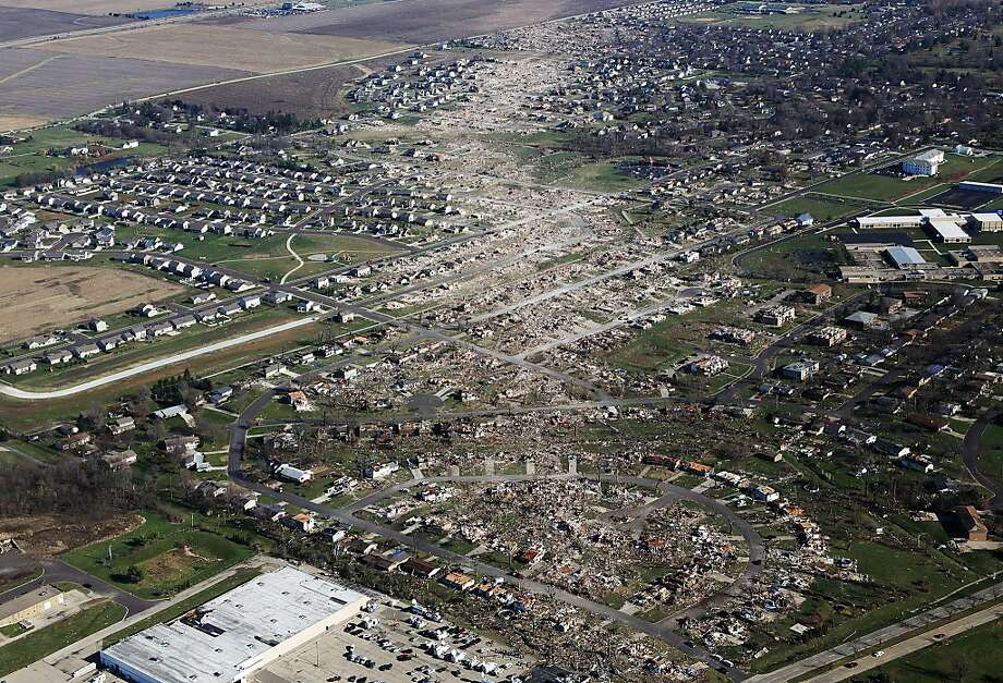Tornado damaged homes are seen on November 18, 2013 in Washington, Illinois. According to reports the tonado that ripped across Washington, Illinois has been preliminary classified as an EF-4. A fast-moving storm system that spawned multiple tornadoes which touched down across the Midwest, leaving behind a path of destruction in 12 states and killing at least five. Photo: Tasos Katopodis, Getty Images