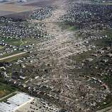 Tornado damaged homes are seen on November 18, 2013 in Washington, Illinois. According to reports the tonado that ripped across Washington, Illinois has been preliminary classified as an EF-4. A fast-moving storm system that spawned multiple tornadoes which touched down across the Midwest, leaving behind a path of destruction in 12 states and killing at least five.