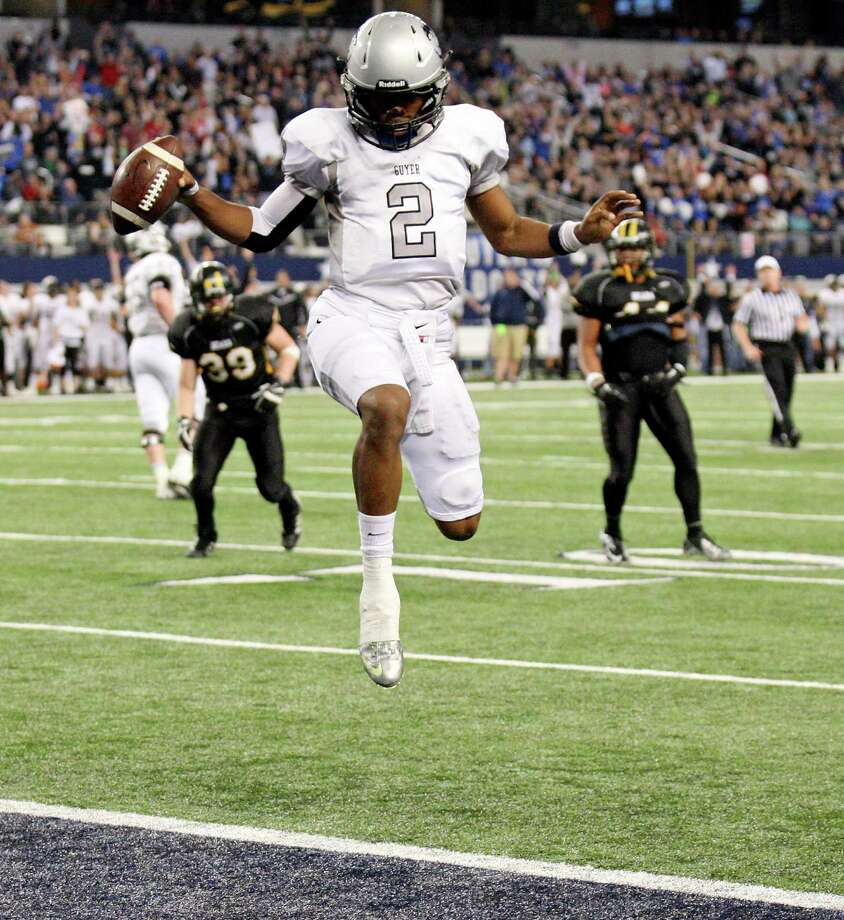 Denton Guyer's Jerrod Heard scores a touchdown against Brennan during first half action of their Class 4A Division I state championship game Friday Dec. 20, 2013 at AT&T Stadium in Arlington, Tx. Photo: San Antonio Express-News / © 2013 San Antonio Express-News