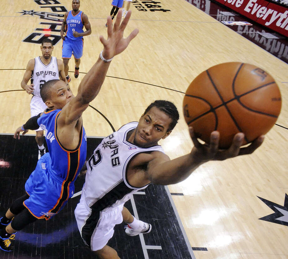 Russell Westbrook (left) and the Thunder sport the NBA's best record. Kawhi Leonard is coming off a 21-point, 10-rebound effort in a win over the Warriors on Thursday. Photo: Edward A. Ornelas / San Antonio Express-News / © 2013 San Antonio Express-News