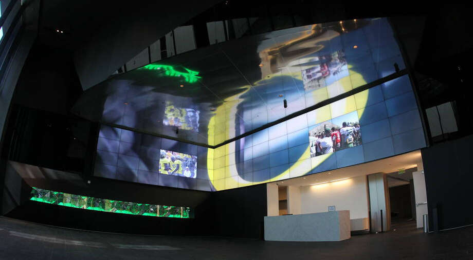 A display of more than 60 individual 55-inch TV screens that can be assembled into a massive display and a glass case of Pac-12 championship rings greets visitors to Oregon's Hatfield-Dowlin Complex, the football team's training facility. Photo: Courtesy Photo