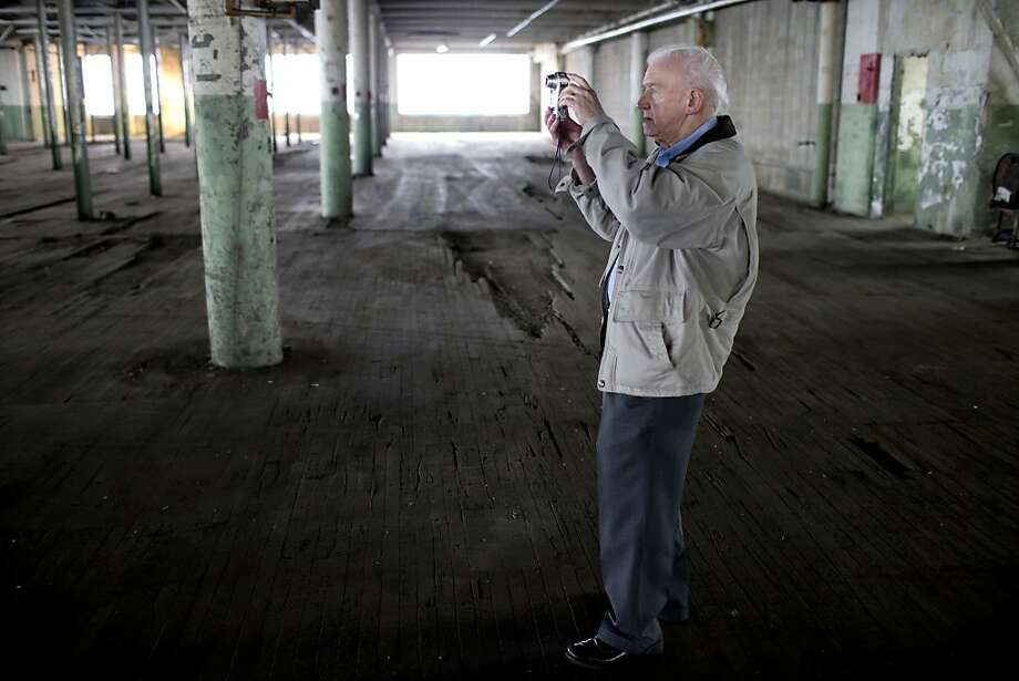 Tom Hayes, a former Studebaker employee for eight years, takes a snap shot of the sixth floor during a tour of the former Studebaker Building 84, the body assembly factory, on Friday, Dec. 20, 2013, in downtown South Bend, Ind. Hayes worked on this floor where upholstery was manufactured for car interiors. Public tours marked the 50th anniversary of the end of Studebaker production in South Bend on Dec. 20, 1963. (AP Photo/South Bend Tribune, James Brosher) Photo: James Brosher, Associated Press