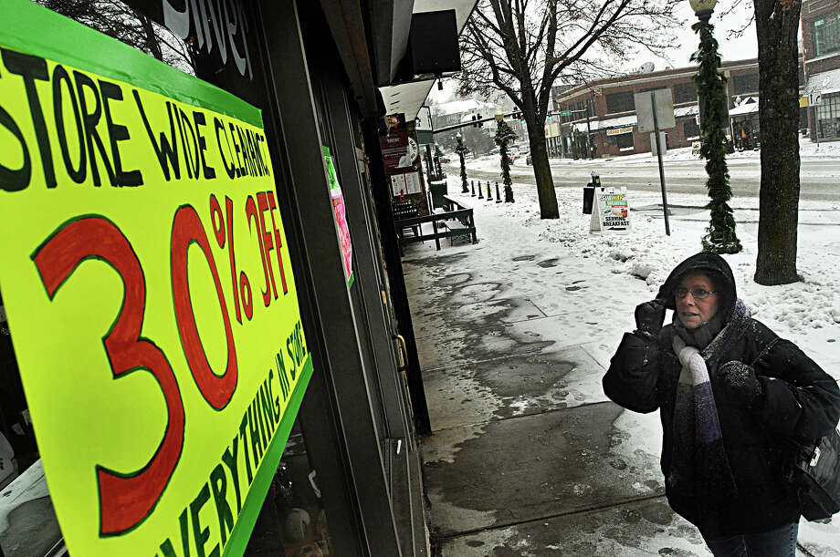 Mary Ellen Wilson, a new resident of Norwalk, looks at a sign announcing the closing sale for SoNo Silver on North Main Street in the South Norwalk section of the city. Wilson said she was planned to shop for a bargain there. Photo: Nancy Guenther Chapman / Norwalk Citizen contributed