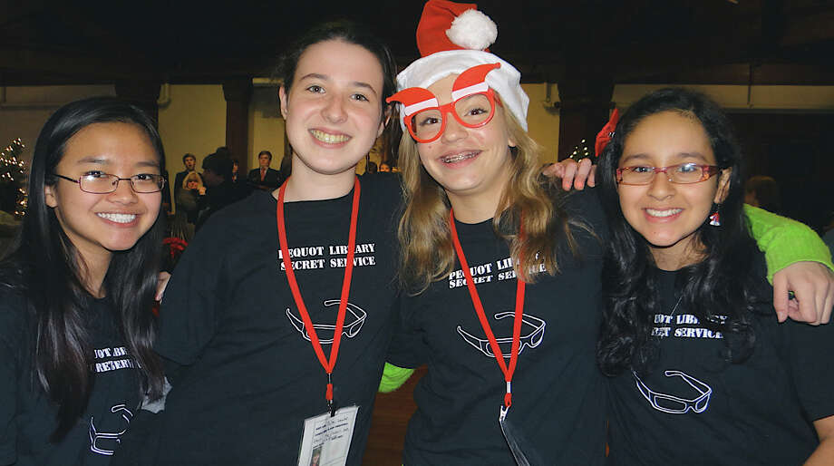 "Pequot Library ""Secret Service Agents"" Joelle Cheng, 14; Julia Lawlor, 14; Meghan Reed, 13, and Amy Cavanillas, 12, at the library's holiday party Friday evening. Photo: Mike Lauterborn / Fairfield Citizen contributed"