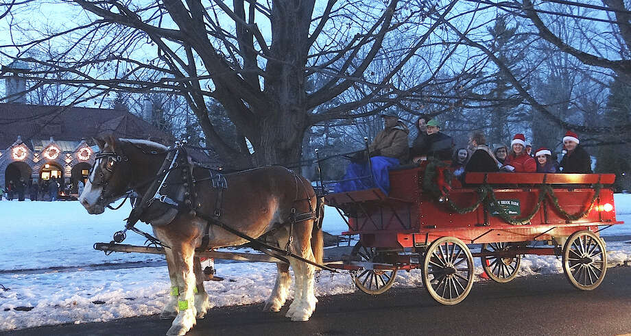 Horse-and-wagon rides were among the holiday attractions at the Pequot Library's annuial community gathering. Photo: Mike Lauterborn / Fairfield Citizen contributed
