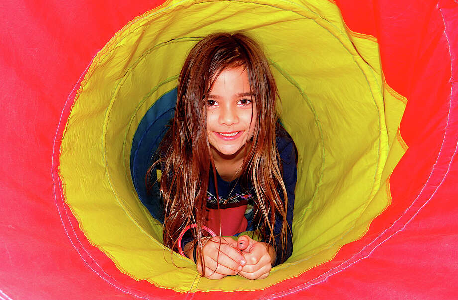 Alex Hackett, 6, of Westport, crawls through a tube in the Gymnastic Center at the Westport Weston Family Y's on Friday evening. Photo: Mike Lauterborn / Westport News contributed