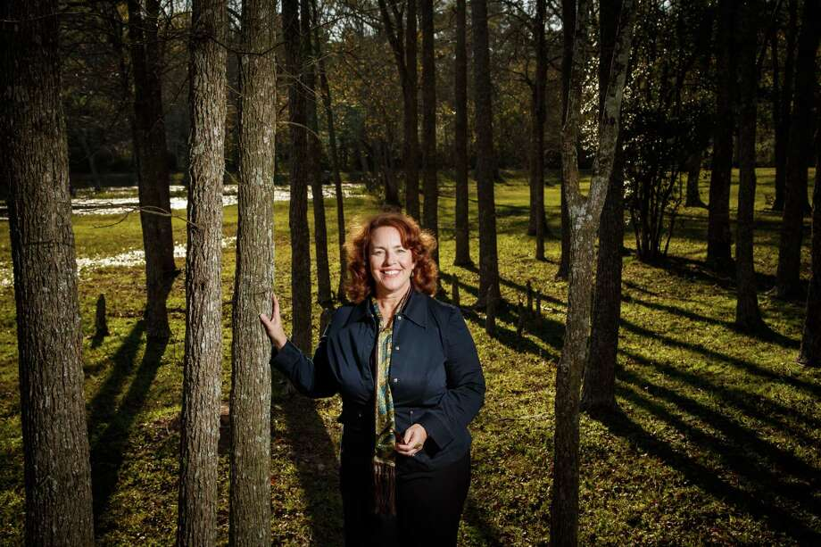 Jennifer Lorenz, executive director of the Bayou Land Conservancy, stands at the Spring Creek Greenway. Photo: Michael Paulsen, Staff / © 2013 Houston Chronicle
