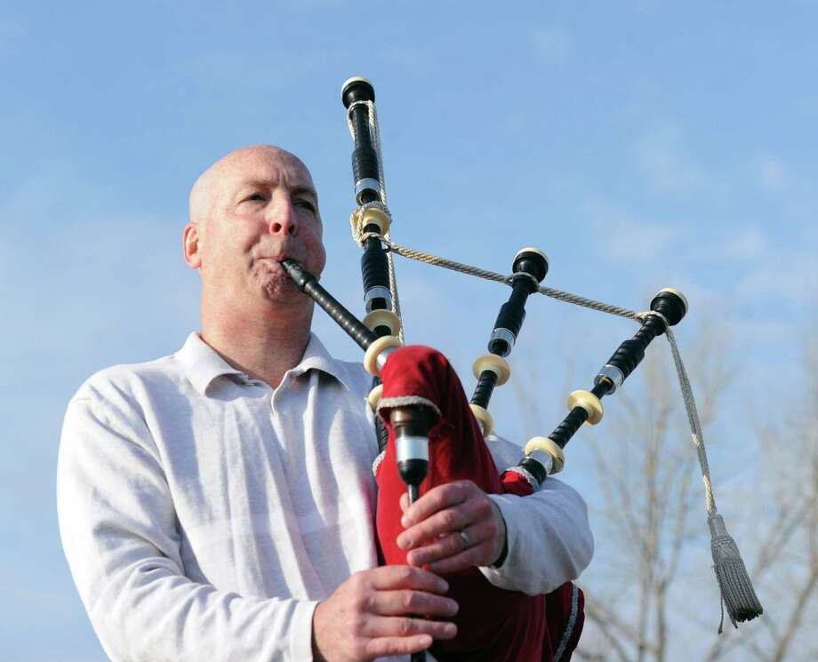 "Darrell Thompson of Durham, N.C., plays ""The Green Hills of Tyrol"", on his bagpipes at Greenwich Point, Saturday afternoon, Dec. 21, 2013. Thompson, who is the band director for the North Carolina State University Pipes & Drums, was in town with his wife, Claire, a Riverside native, visiting for the holidays. Thompson says he brings his pipes with him when he travels because he likes to keep them in tune or as he prefers to say ""keep them happy."" Photo: Bob Luckey / Greenwich Time"