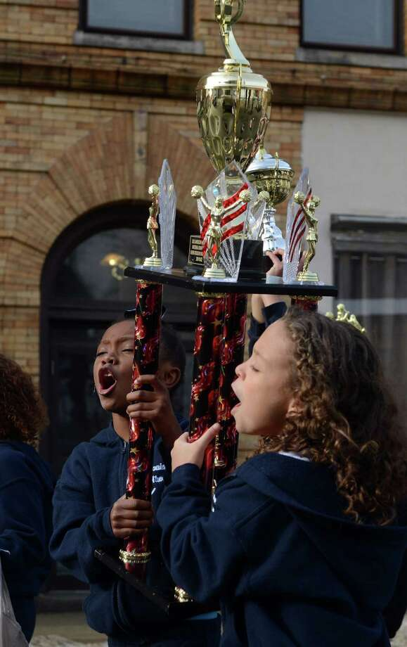A parade to honor Class S state football champions, the Ansonia Chargers, and Ansonia Youth cheerleaders, AYC National Championship winners and runners-up, was held Saturday, Dec. 21, 2013 in downtown Ansonia, Conn. Photo: Autumn Driscoll / Connecticut Post