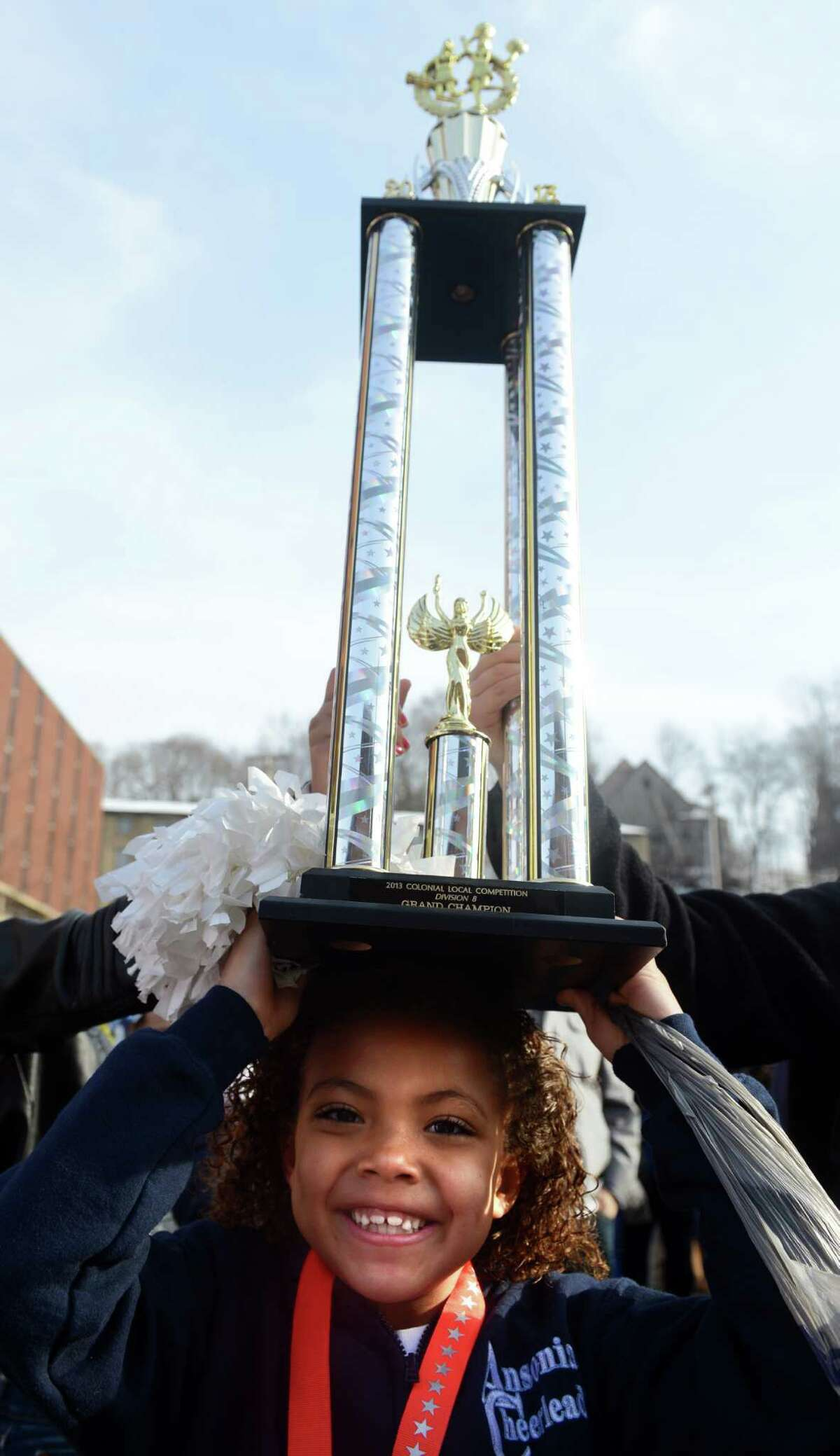 A parade to honor Class S state football champions, the Ansonia Chargers, and Ansonia Youth cheerleaders, AYC National Championship winners and runners-up, was held Saturday, Dec. 21, 2013 in downtown Ansonia, Conn.