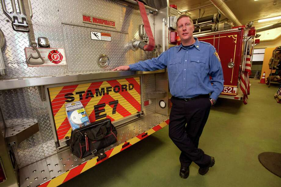 Capt. Victor Rella stands with a smoke and carbon monoxide alarm installation kit at Springdale Fire Company on Friday, December 20, 2013. The station keeps the kits on hand and uses them at homes where they find owners are without the alarms. Photo: Lindsay Perry / Stamford Advocate