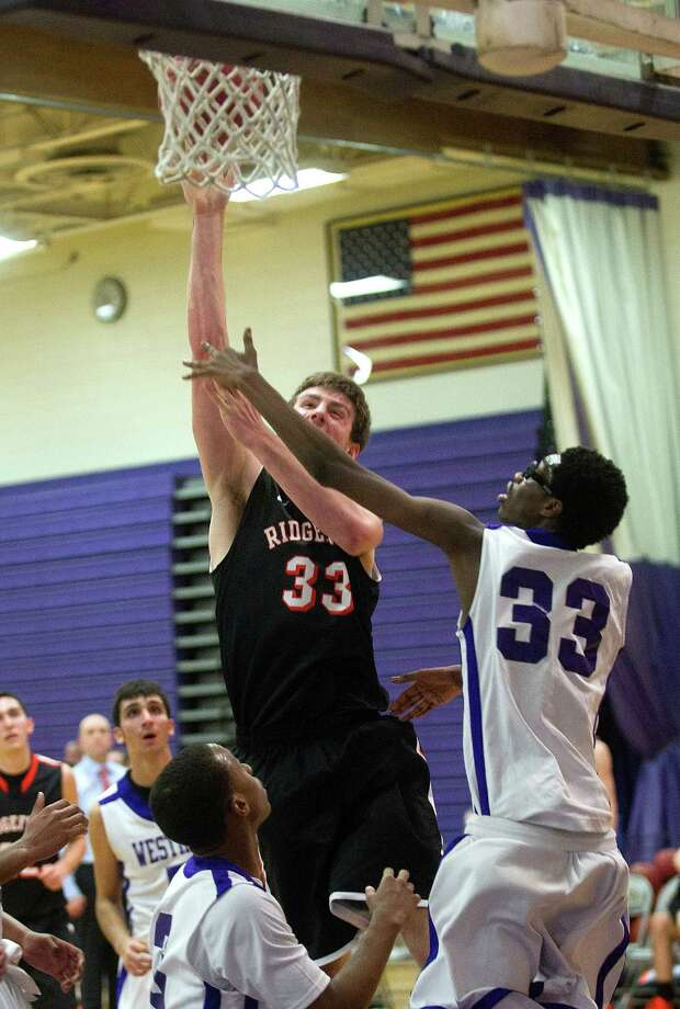 Ridgefield's Patrick Racy takes a shot during Friday's basketball game against Westhill in Stamford, Conn., on December 20, 2013. Photo: Lindsay Perry / Stamford Advocate
