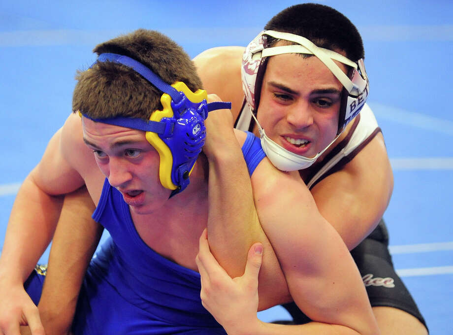 Newtown's Alex Stavola, left, and Victor Vieira, during wrestling action in Fairfield, Conn. on Saturday December 21, 2013. Photo: Christian Abraham / Connecticut Post