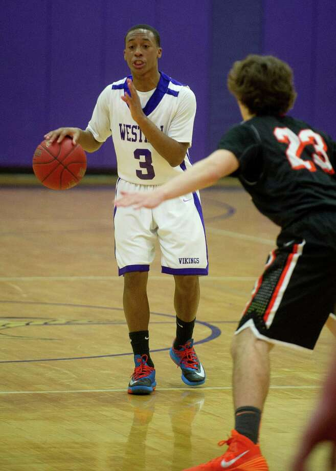 Westhill's C.J. Donaldson controls the ball during Friday's basketball game against Ridgefield in Stamford, Conn., on December 20, 2013. Photo: Lindsay Perry / Stamford Advocate