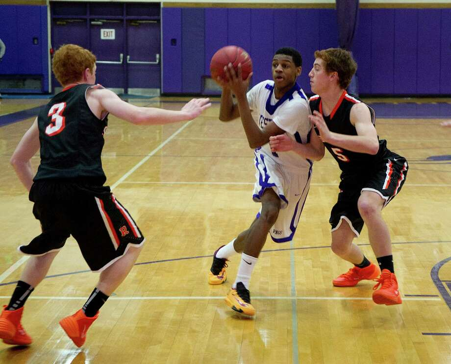 Westhill's Jeremiah Livingston controls the ball during Friday's basketball game against Ridgefield in Stamford, Conn., on December 20, 2013. Photo: Lindsay Perry / Stamford Advocate