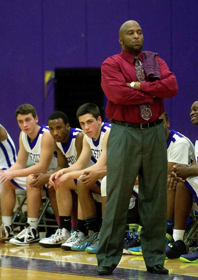 Westhill head coach Howard White watches his team during Friday's basketball game in Stamford, Conn., on December 20, 2013. Photo: Lindsay Perry / Stamford Advocate