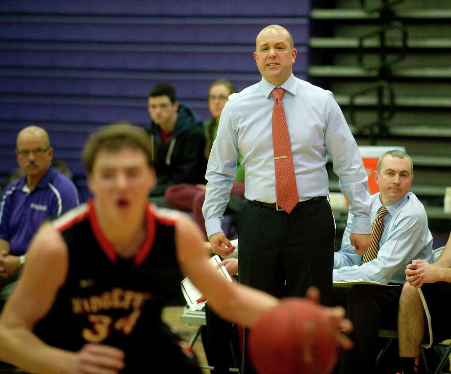Ridgefield's head choach Andrew McClellan talks to his team during Friday's basketball game at Westhill High School in Stamford, Conn., on December 20, 2013. Photo: Lindsay Perry / Stamford Advocate