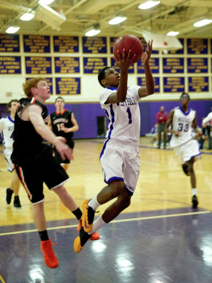 Westhill's Jeremiah Livingston takes a shot during Friday's basketball game against Ridgefield in Stamford, Conn., on December 20, 2013. Photo: Lindsay Perry / Stamford Advocate