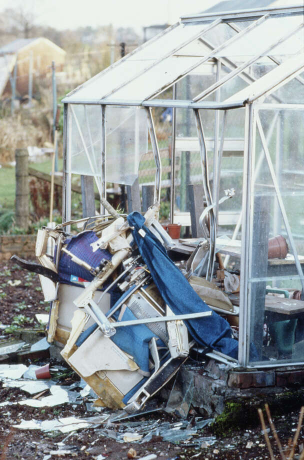 Some of the wreckage of Pan Am Flight 103 lies next to a domestic greenhouse on Dec. 22, 1988, the day after it crashed  onto the town of Lockerbie in Scotland. Photo: Georges De Keerle, Getty Images / 2011 Georges DeKeerle