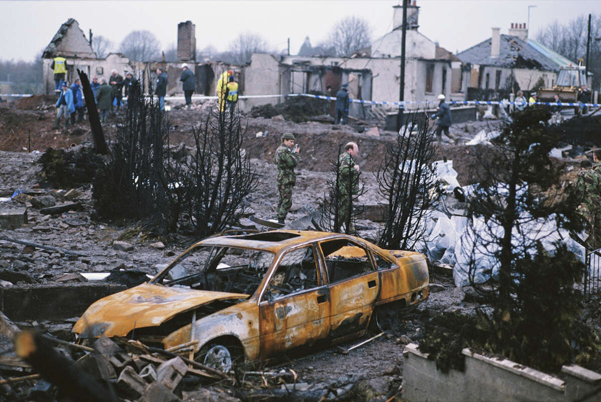 Some of the destruction caused by Pan Am Flight 103 after it crashed onto the town of Lockerbie in Scotland, on Dec. 21, 1988. The Boeing 747 'Clipper Maid of the Seas' was destroyed en route from Heathrow to JFK Airport in New York, when a bomb was detonated in its forward cargo hold. All 259 people on board were killed, as well as 11 people in the town of Lockerbie.