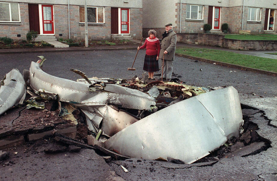 Local resident Robert Love and an unidentified woman stand by one of the four engines of the ill-fated Pan Am 747 Jumbo jet the day after it exploded and crashed into the town of Lockerbie on Dec. 21, 1988. Photo: ROY LETKEY, AFP/Getty Images / 2011 AFP