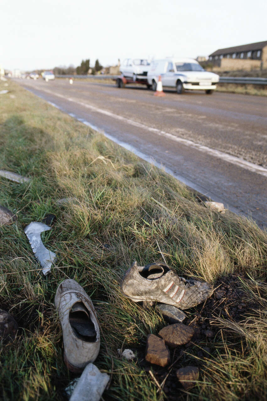 Shoes from the wreckage of Pan Am Flight 103 are seen by a roadside in the town of Lockerbie in Scotland on Dec. 22, 1988.