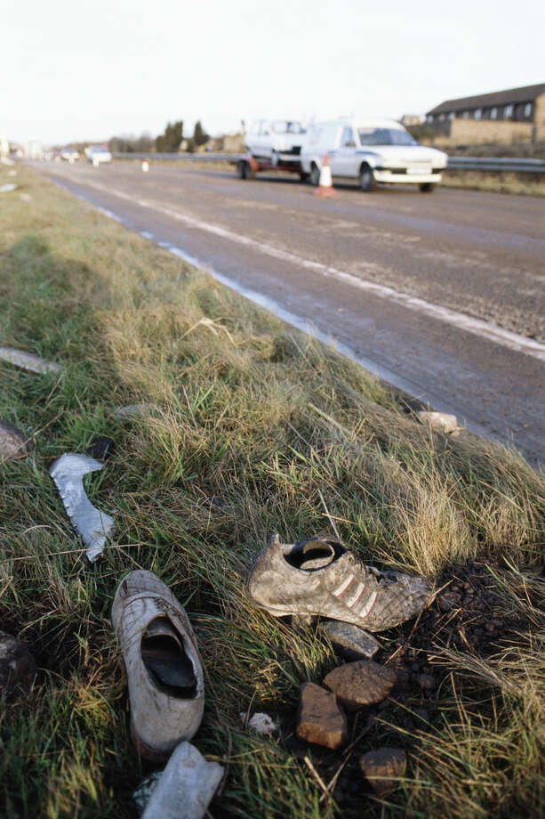 Shoes from the wreckage of Pan Am Flight 103 are seen by a roadside in the town of Lockerbie in Scotland on Dec. 22, 1988. Photo: Georges De Keerle, Getty Images / 2011 Georges DeKeerle