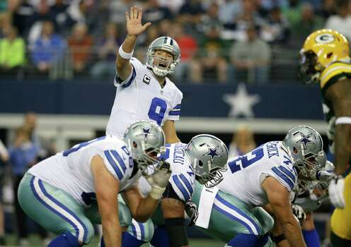 Dallas Cowboys quarterback Tony Romo (9) lines up for the snap during the first half or an NFL football game against the Green Bay Packers Sunday, Dec. 15, 2013, in Arlington, Texas. (AP Photo/Tony Gutierrez) Photo: Tony Gutierrez, Associated Press / AP