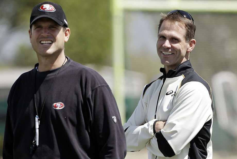 San Francisco 49ers general manager Trent Baalke, right, smiles with head coach Jim Harbaugh, left, during the team's NFL football training camp in Santa Clara, Calif., Wednesday, April 18, 2012. Apparently, there are no hard feelings on Baalke's part regarding the Saints' targeting of San Francisco players in their bounty program. Baalke recently reached out to suspended former New Orleans defensive coordinator Gregg Williams to discuss the matter. (AP Photo/Paul Sakuma) Photo: Paul Sakuma, Associated Press