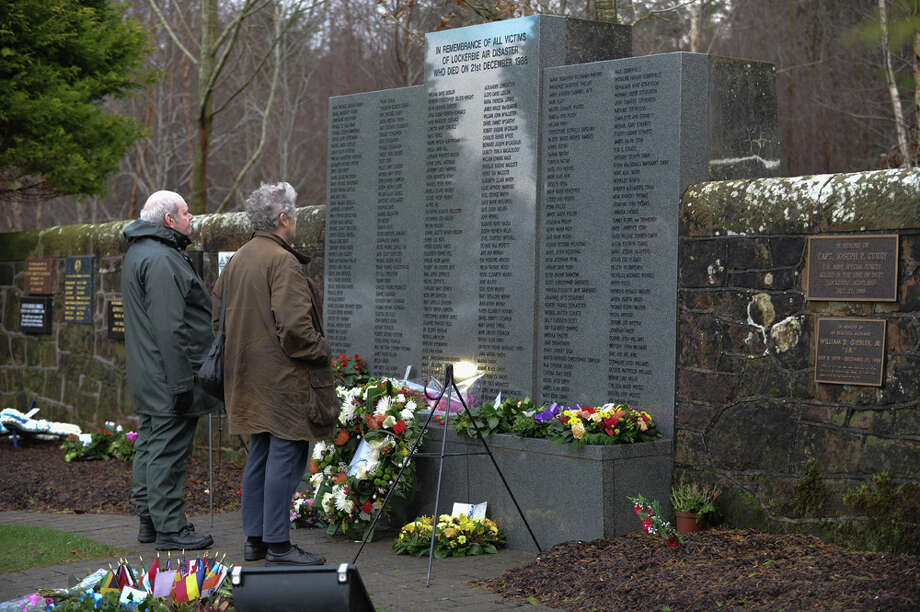 On Dec. 21, 2013, a couple reads the names of those who were killed in the Lockerbie bombing on the 25th anniversary of the tragedy at the memorial wall in Dryfesdale Cemetery in Lockerbie, Scotland. Pan Am Flight 103 exploded over Lockerbie on Dec. 21, 1988, causing the deaths of all 259 on board and a further 11 people on the ground. Photo: Ian Forsyth, Getty Images / 2013 Getty Images