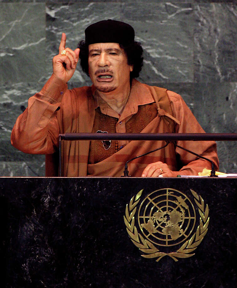 Libyan leader Col. Moammar Gadhafi, seen here speaking at the United Nations headquarters on Sept. 23, 2009, admitted to Libya's involvement in the bombing while denying personal responsibility in 2003, and paid compensation to the families of the victims. Gadhafi was killed by a violent militia group during the Libyan civil war in the Arab Spring of 2011. Photo: Rick Gershon, Getty Images / 2009 Getty Images