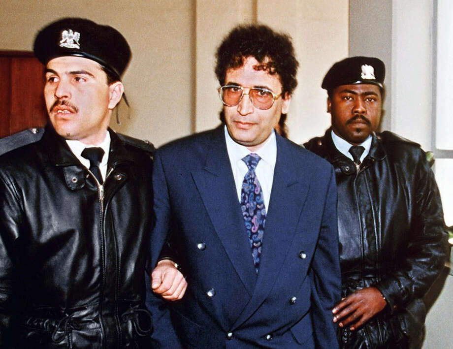 A Libyan intelligence officer, Abdelbaset Ali Mohmet al-Megrahi (center), seen on Feb. 18, 1992, was the only person ever convicted in the Lockerbie bombing. He wasn't arrested for the terrorist attack until 1999, and was convicted in 2001. However, he only served eight years in prison, as the British government granted him a compassionate release in 2009 when he was diagnosed with prostate cancer. He died in 2012. Photo: MANOOCHER DEGHATI, AFP/Getty Images / 2009 AFP