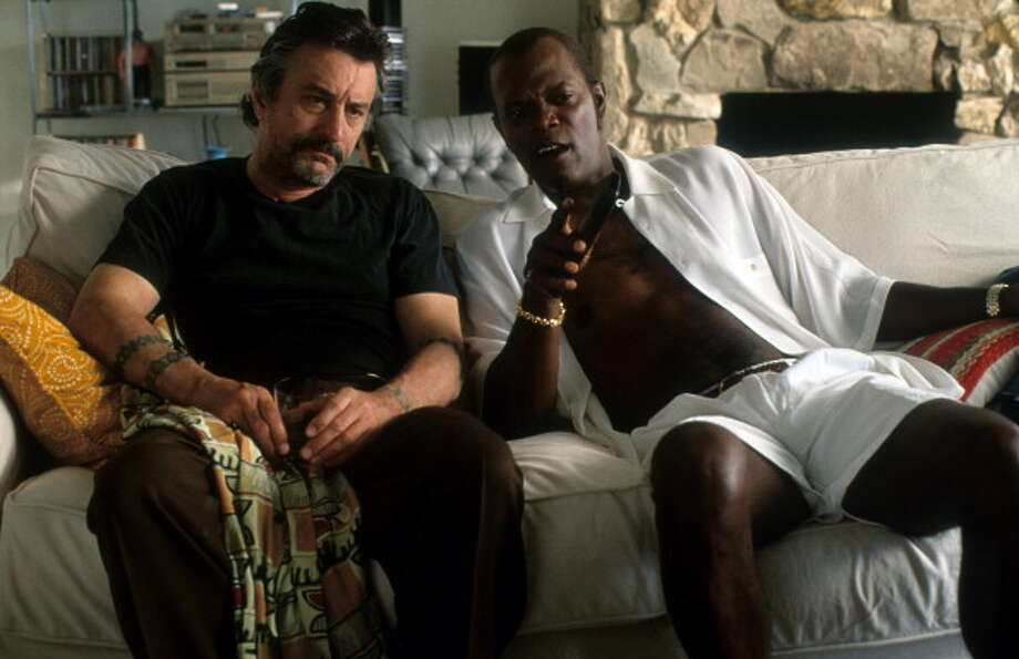 Robert De Niro and Samuel L Jackson sit on a couch in a scene from the film 'Jackie Brown', 1997. Photo: Hulton Archive, Getty Images / 2012 Getty Images