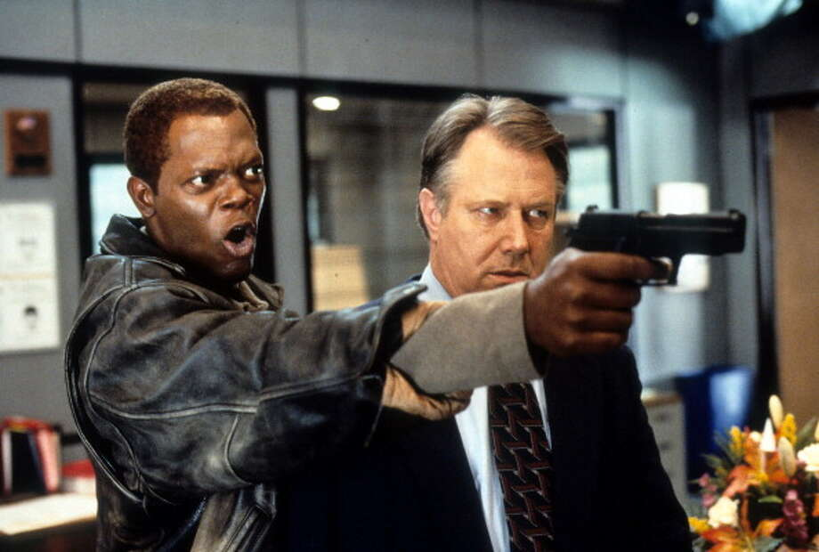 Samuel L Jackson holds a gun in a scene with J T Walsh from the film 'The Negotiator', 1998. Photo: Archive Photos, Getty Images / 2012 Getty Images