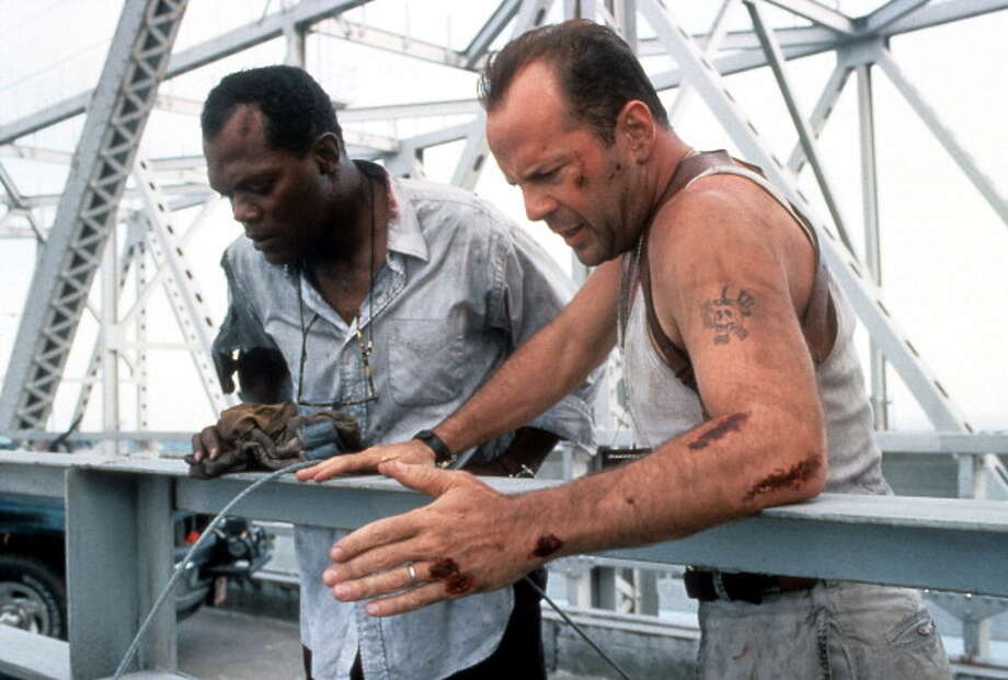 Samuel L Jackson and Bruce Willis standing on a bridge, looking down in a scene from the film 'Die Hard: With a Vengeance', 1995. Photo: Archive Photos, Getty Images / 2012 Getty Images
