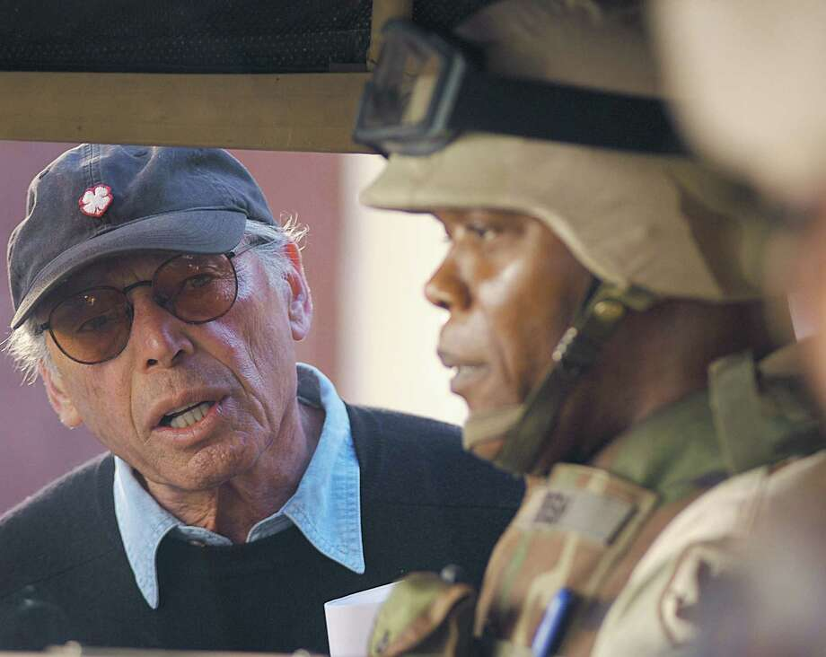 "In this photo provided by Chasen and Company, Irwin Winkler, left, director of the upcoming movie ""Home of the Brave,"" works with actor Samuel L. Jackson as they film the movie last March in Morocco. Hip-hop music superstar 50 Cent plays a soldier in the movie. (AP Photo/Courtesy Chasen and Company) ** NO SALES ** Photo: AP Photos / COUTESY CHASEN AND COMPANY"